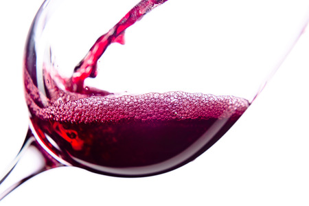glass of red wine:  Red wine in wineglass on white background Stock Photo