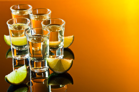 tequila and lime on a black glass table.Free space for the text from the right photo