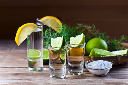 alcoholic drink with citrus on a old wooden table photo