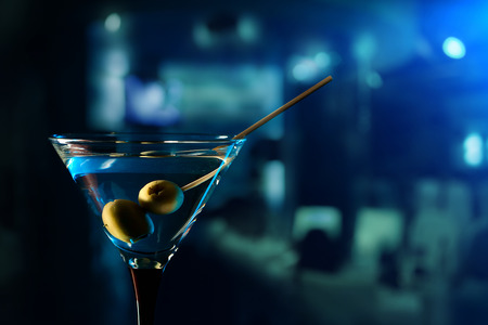 glass with martini , focus on a olives Archivio Fotografico