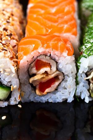 reflexive: Appetizing Japanese sushi on black reflexive background
