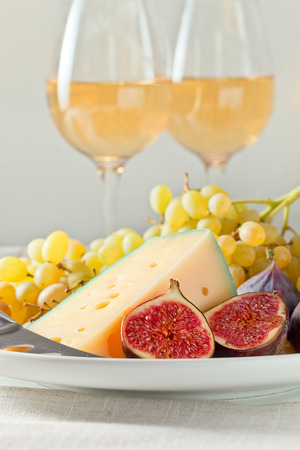 cheese , fruits and glasses with white wine photo