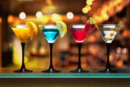Different cocktails or longdrinks garnished with fruits