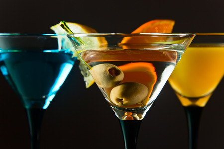 berryes: martini with green olives , focus on a berryes Stock Photo
