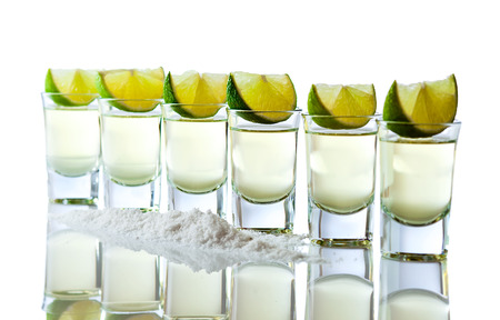 reflexive: tequila , lime and salt isolated on white reflexive background