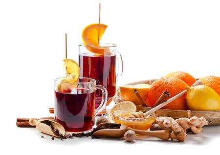 The mulled wine with spices and fruits Stockfoto
