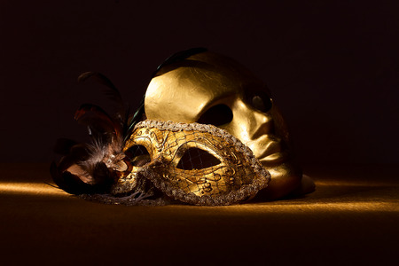 Two golden Venetian masks , focus on foreground Stock Photo