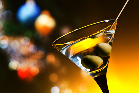 alcohol drinks: dry martini with olives ,focus on a berry