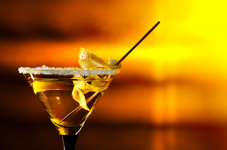 horizontal bar: cocktail with lemon , focus on a foreground