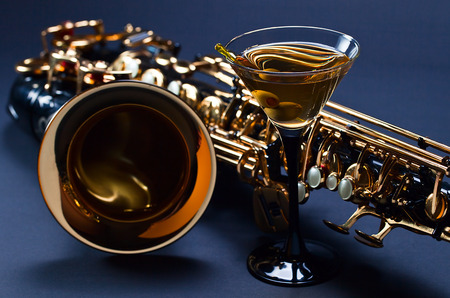 saxophone: saxophone and martini with green olives , focus on foreground Stock Photo