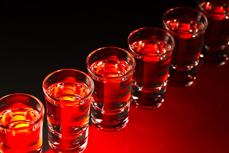 alcoholic drink: Glasses with an alcoholic drink on a glass table Stock Photo