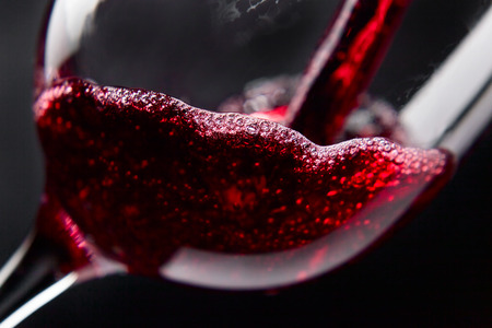 horizontal bar: Red wine in wineglass on  black background Stock Photo