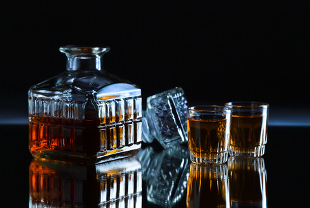crystal glasses with whiskey on a dark background photo