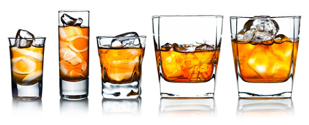 alcoholic drinks with natural ice isolated on white reflexive background Banco de Imagens