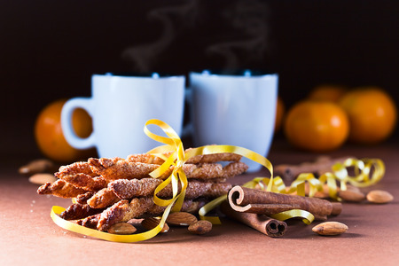 The cookies with cinnamon and almond nuts photo