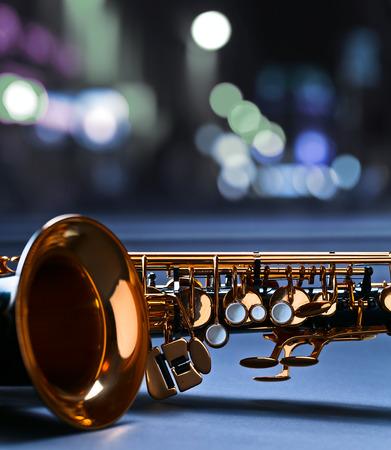 saxophone: saxophone before a window in nightclub Stock Photo