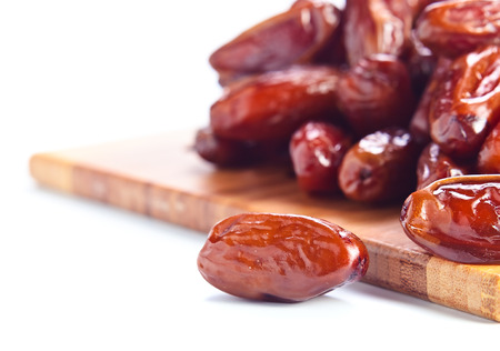 frutos secos: Dried dates isolated on a white background