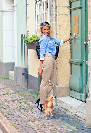 latvia girls: young woman with chihuahua in old city.