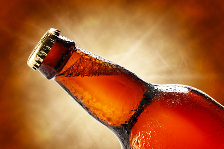vapour: Cold beer bottle with drops, frost and vapour