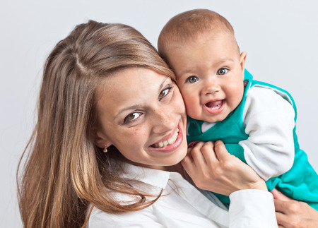 Happy young mum with the baby photo