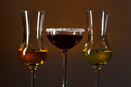 grappa: Glasses of grappa on a dark background