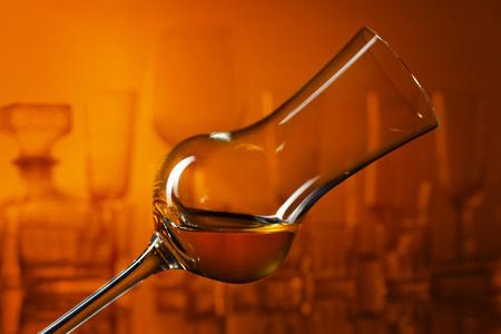 Glass of grappa on a dark background 版權商用圖片