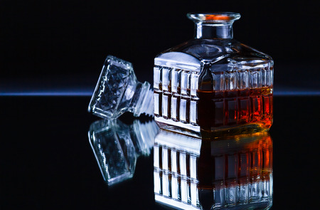 decanter: crystal whiskey decanter on a dark background