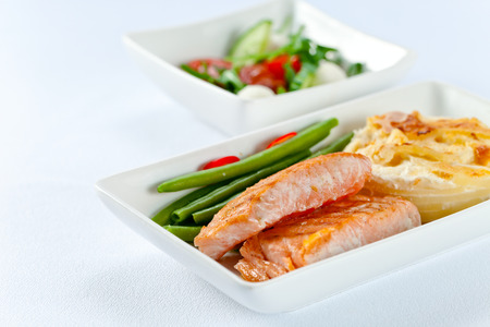 dinner plate: grilled salmon  with amleto and beans Stock Photo