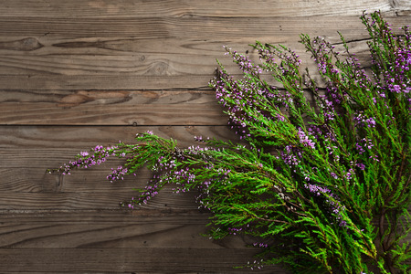 flowering Heather on old wooden table photo