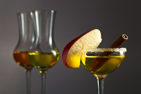 punch spice: apple liquor with cinnamon on a dark background Stock Photo