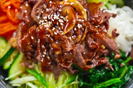 Roasted meat with vegetables and sauce.  Korean cuisine. photo