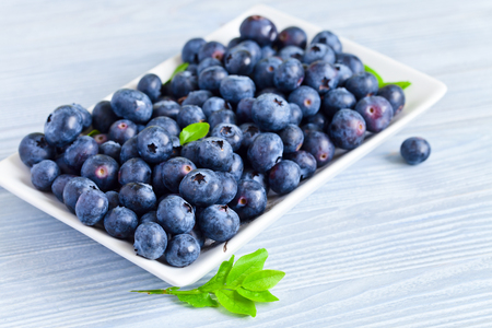 woden: Blueberries, ripe berries on a old woden table
