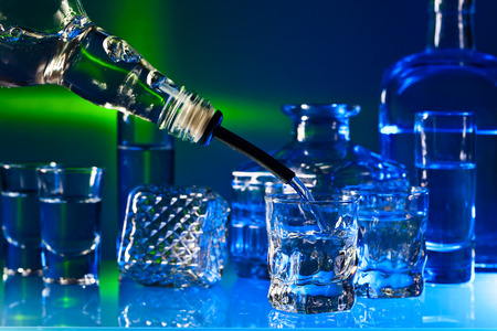 drinks on bar: alcoholic drinks in bar on a glass table