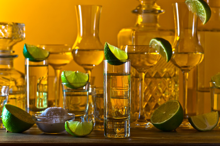 alcoholic drinks: alcoholic drinks with lime on wooden table