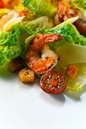caesar salad: Caesar salad with tomatoes, toasts and shrimps Stock Photo