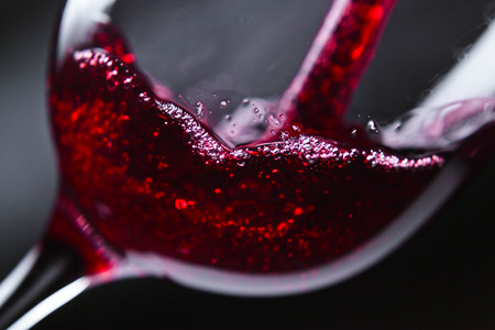 wineglasses: Red wine in wineglass on dark