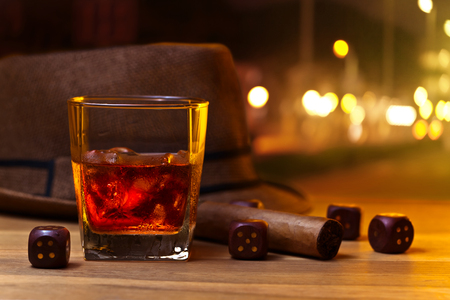 bourbon street: whiskey and dice on a wooden table