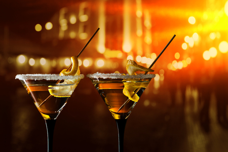 sweet vermouth: glasses of Martini with lemon and sugar