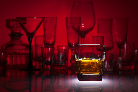 alcoholic drink: alcoholic drink on a glass table in bar