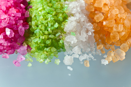 mineral salt: The flavoured sea salt on a glass table Stock Photo