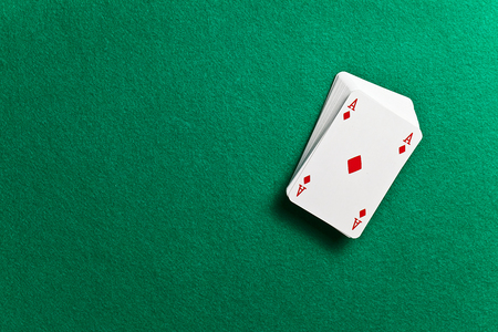 business table: playing cards on green table in cacino