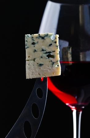 gorgonzola: Gorgonzola and red wine on  black background