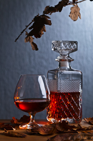 brandy: snifter of brandy and dried oak leaves
