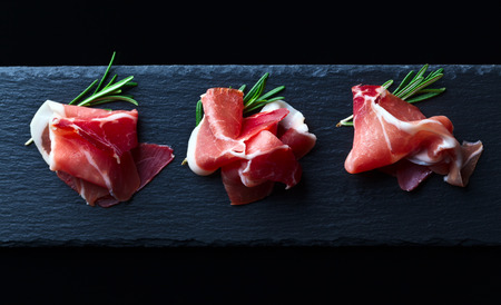 jamon with rosemary on  a black background