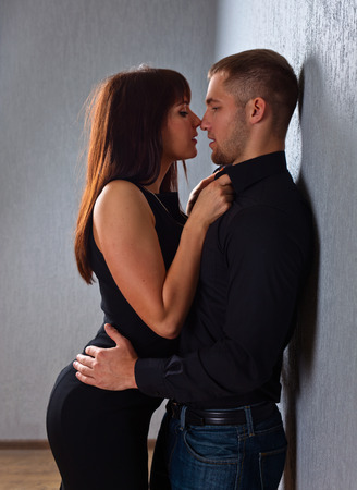 sexy couple black background: The young beautiful couple in love