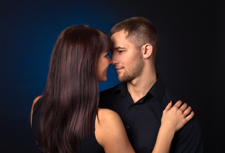 sexy couple black background: The couple in love on dark background