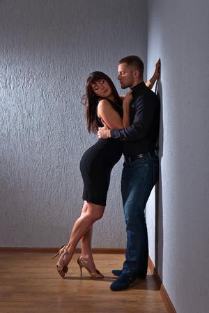 two men: The young beautiful couple in love , studio shot
