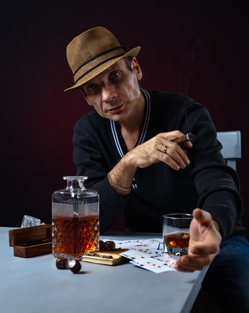hombre fumando puro: man with whiskey and cigar, studio shot