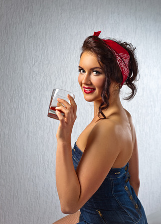 liquor girl: portrait of young beautiful woman with whiskey