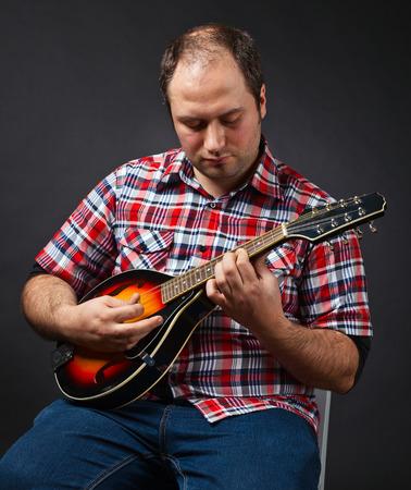 mandolin: portrait of musician with mandolin Stock Photo